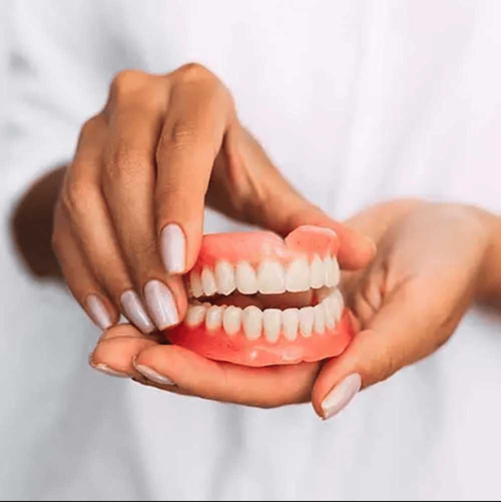 Traditional Dentures being shown to patient